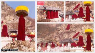 Le statue buddhiste che si trovano all'aperto nella Grotta dei mille Buddha avvolte in teli rossi