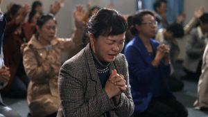 Credenti in una chiesa di casa